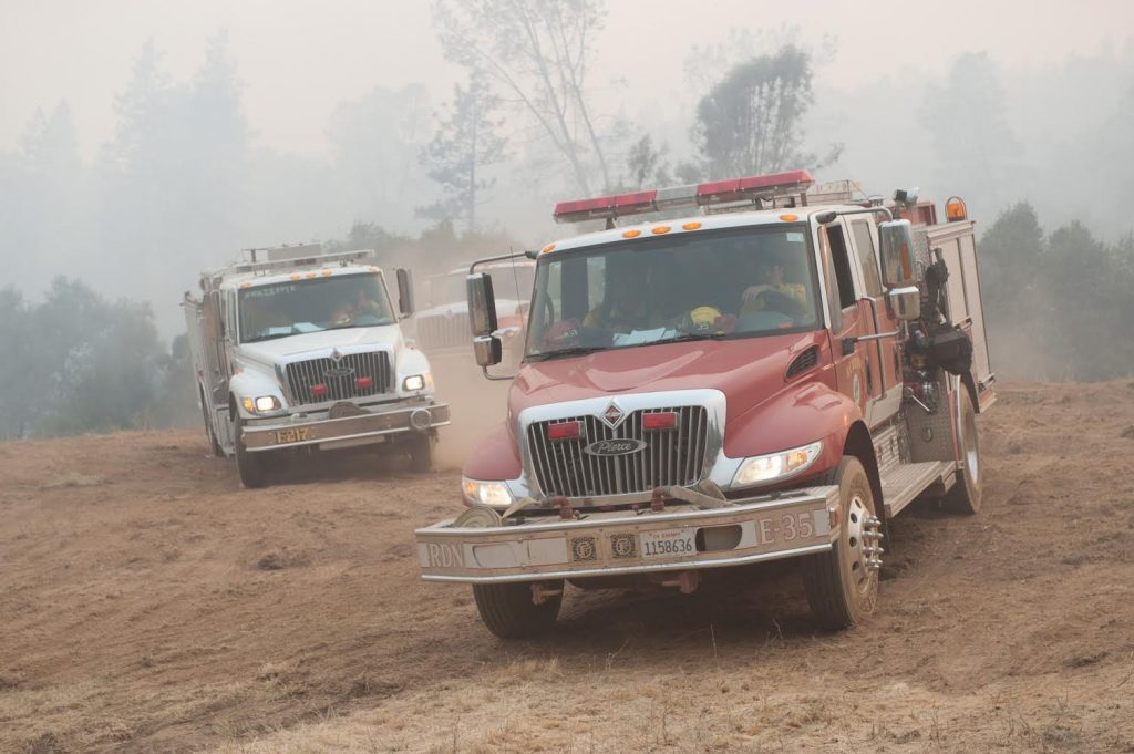 A Cal Fire Strike Team leaves a safety area and heads to fight the Carr Fire.