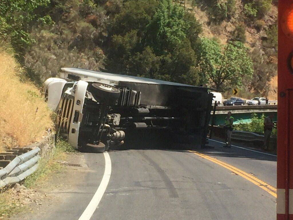 Box truck on its side north of Leggett