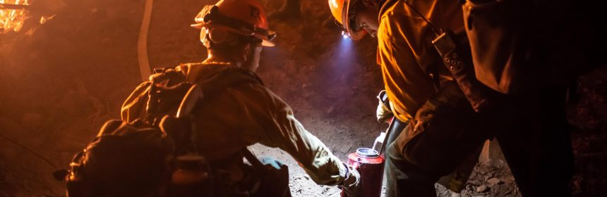 Members of the Little Tujunga Hotshots refill a drip torch during burning operations along the fireline between Mid Mountain Road and the Eel River west of Lake Pillsbury on Monday night, August 13.