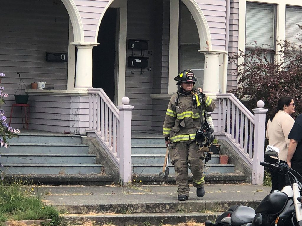 Firefighter in front of the multi unit building.