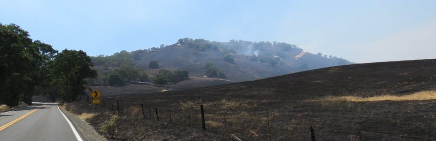 The hills around Hwy 20 are charred but the road is reopened.