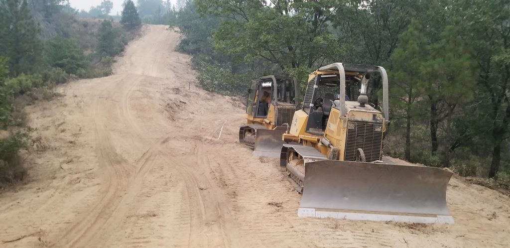 Dozer lines provide wide swaths of empty land that the Carr Fire will have to struggle to cross.Dozer lines provide wide swaths of empty land that the Carr Fire will have to struggle to cross.