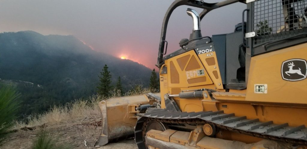 Fire glowing above Igo and as dozer piloted by a Humboldt County crew from Paula and Sons Earthworks rests