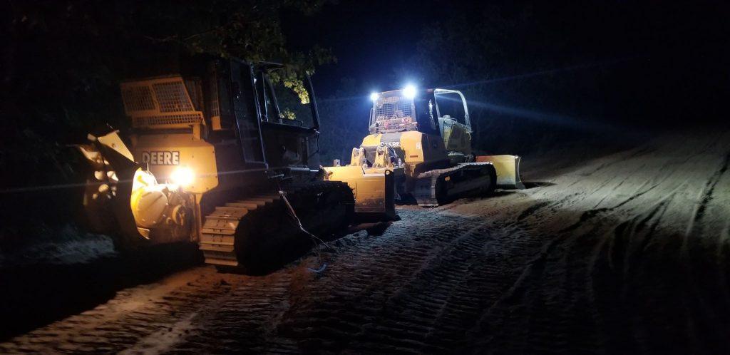 Dozer crews work through the night to protect the town of Igo.