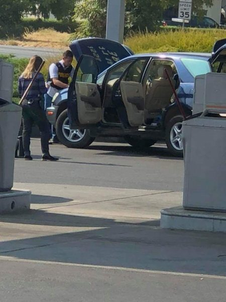 Officers search the vehicle of Ulisses Rodriguez, a suspect in the two deaths.