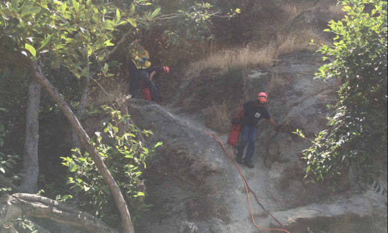 Rescuers recovering ropes from rescue scene