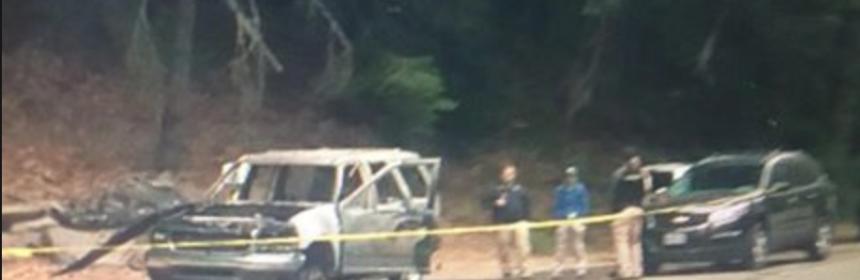 Investigators at the scene of a double homicide