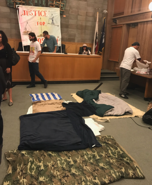 Sleeping bags, pizza, and protesters still in the chambers at 9 p.m.