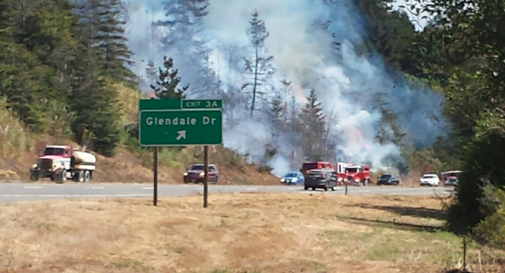 Firefighters are on a rapidly spreading fire near State Route 299.
