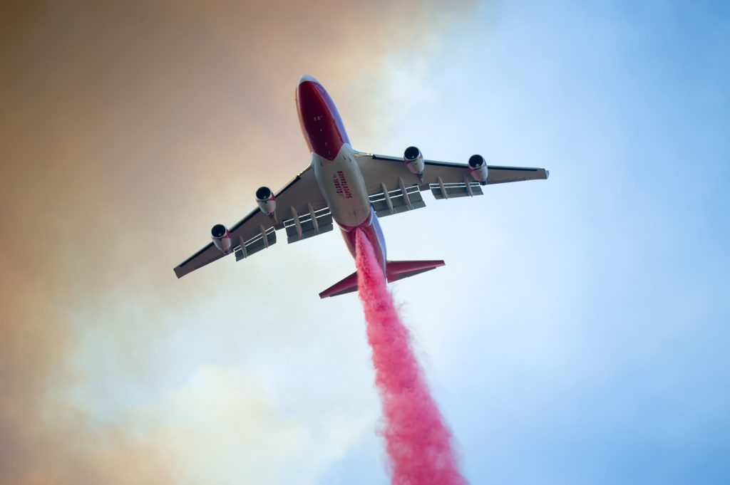 A super tanker begins a fire retardant drop on The River Fire near Scott's Valley Road in Lake County California on Friday.