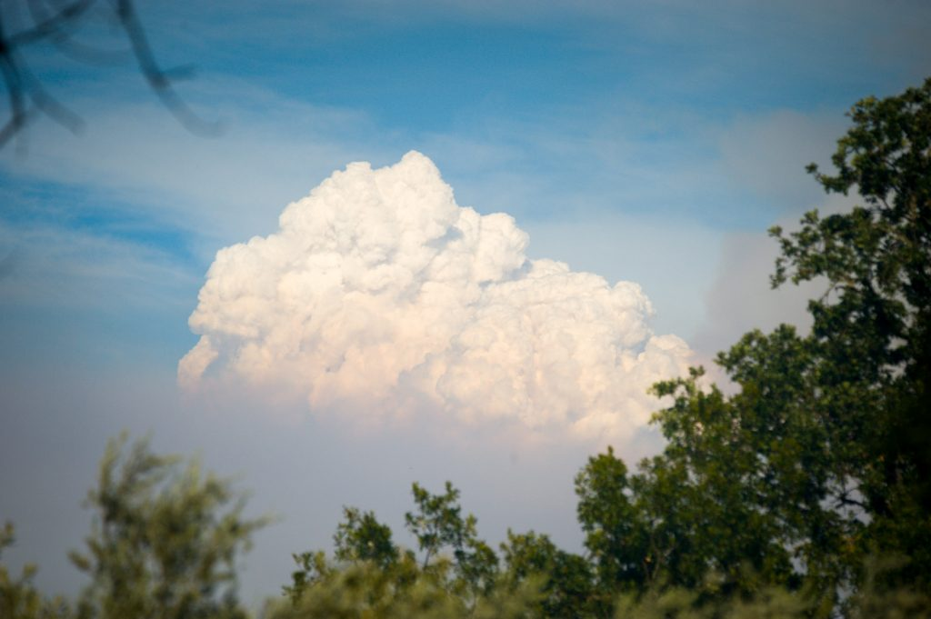 A column of smoke column billows up from The Ranch Fire over Upper Lake in Lake County California noon Friday