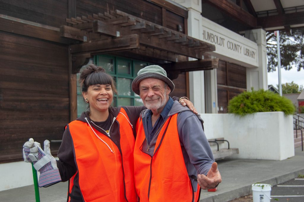 Helping Humboldt participants Kirstie Wright and Ross Lewis, both of Eureka, stand in front of the Humboldt County Library's main branch in Eureka.