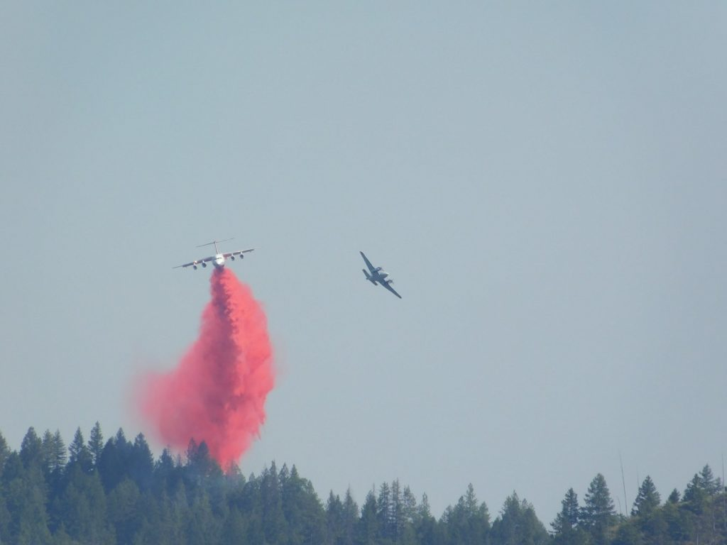 BAe-146 and a smaller plane battling the Carr Fire in the hills above Lewiston.