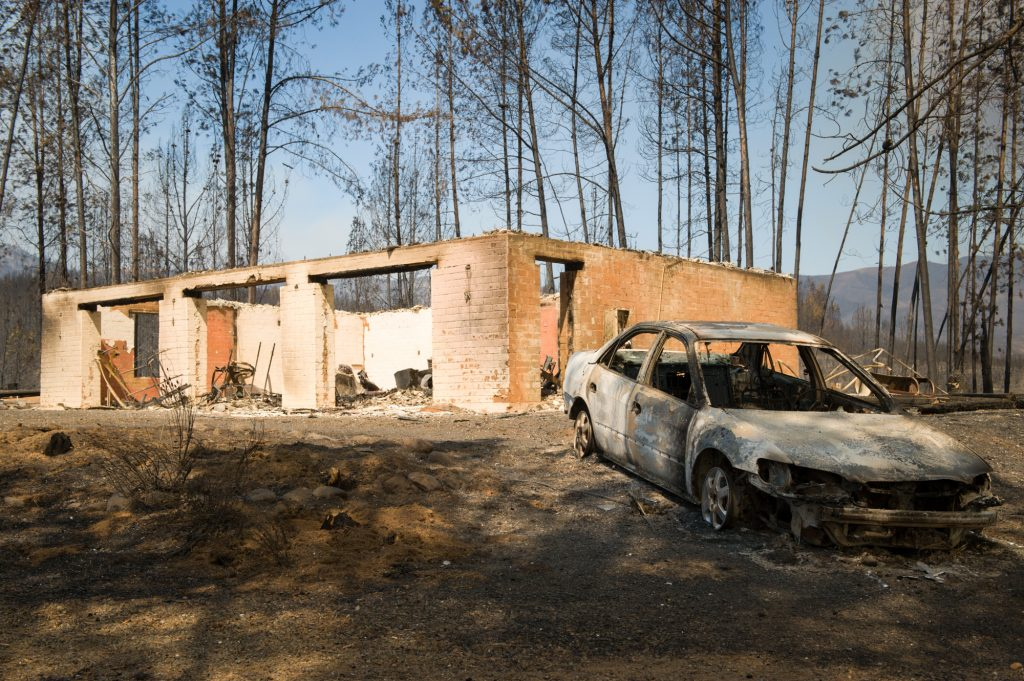 A burned car and house were not saved from the River Fire burning in Lake County California.