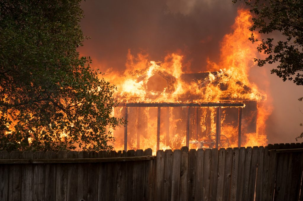 A Spring Valley house is consumed by flames as the Ranch Fire continued to expand westward.