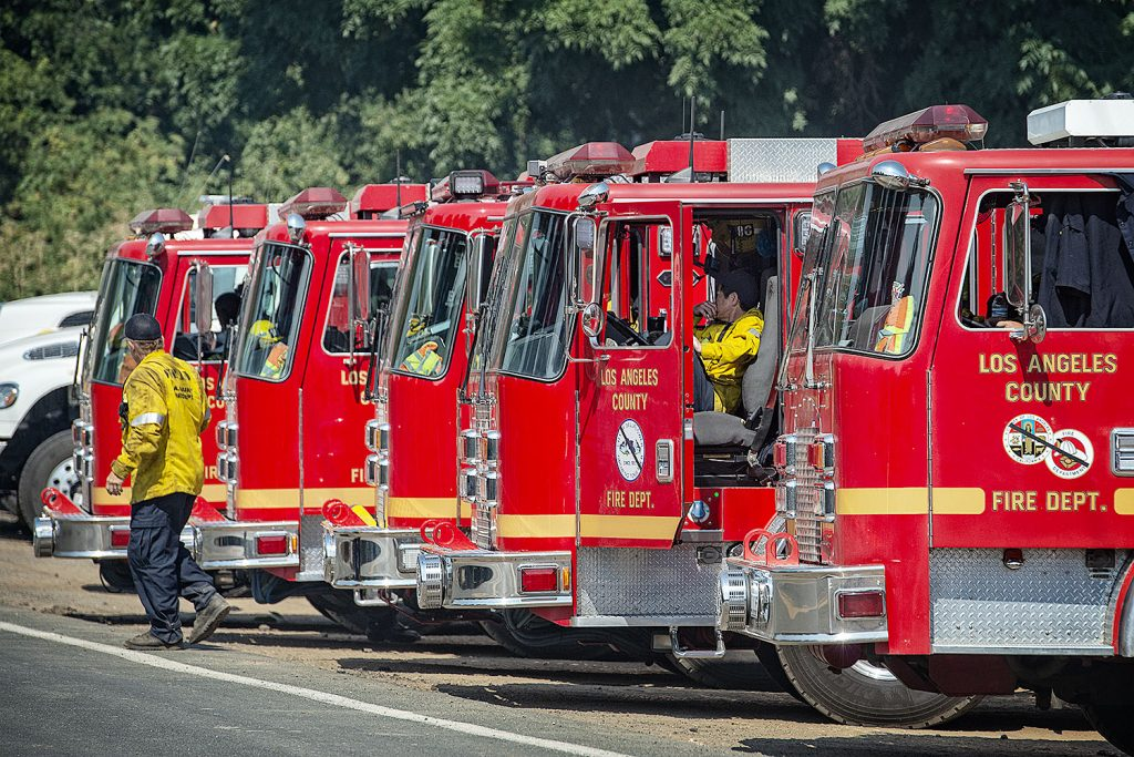 A group of engines from Los Angeles waits for their assignment on Scotts Valley road near Lakeport