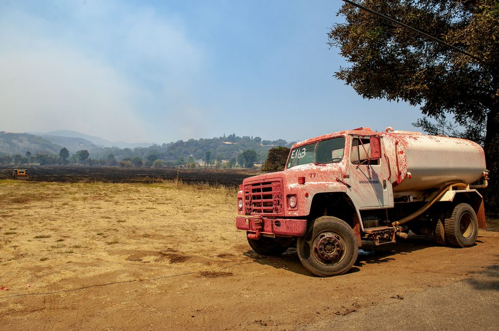 "A water tender parked on Scotts Valley Road near Lakeport was ""painted' with fire retardant."