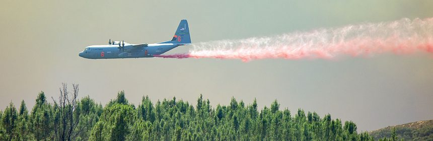 A C-130 Air Tanker drops fire retardant on a ridge West of Scotts Valley Road.