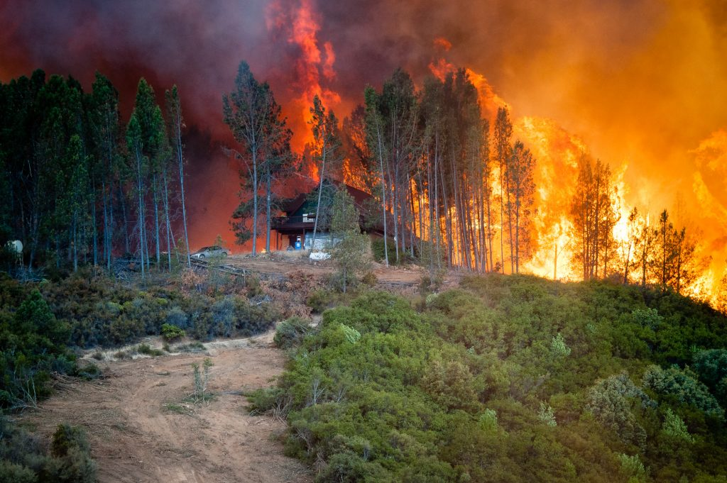 Flames from the River Fire erupt near a house off of Scott's Valley Road in Lake County California on Thursday.