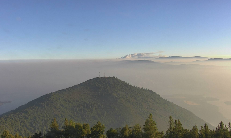 A plume of smoke rises from Ranch Fire's northern edge as seen from the Mount Konocti cam.