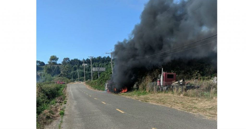 Black smoke boils from the vehicle.
