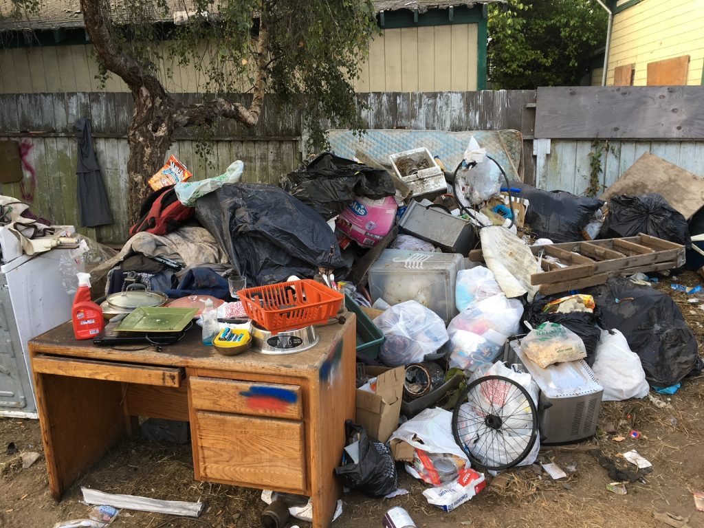 hazardous construction, large accumulations of garbage, rodent infestations, fire hazards and unsanitary conditions, including a lack of running water and the use of backyard latrines.