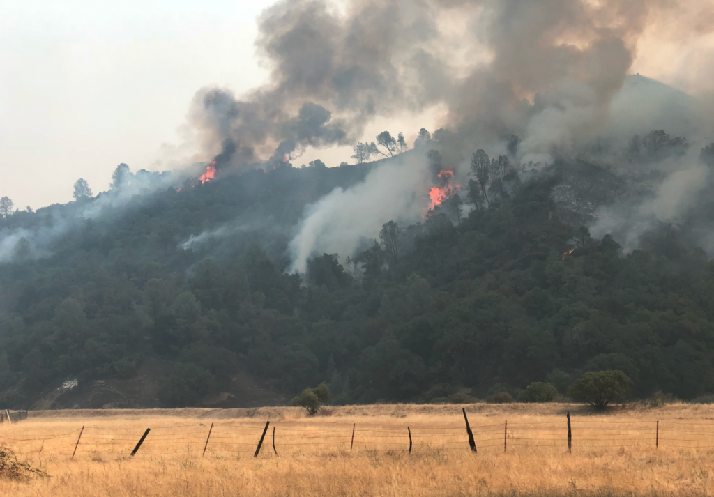 Flames pushing into Clover Valley