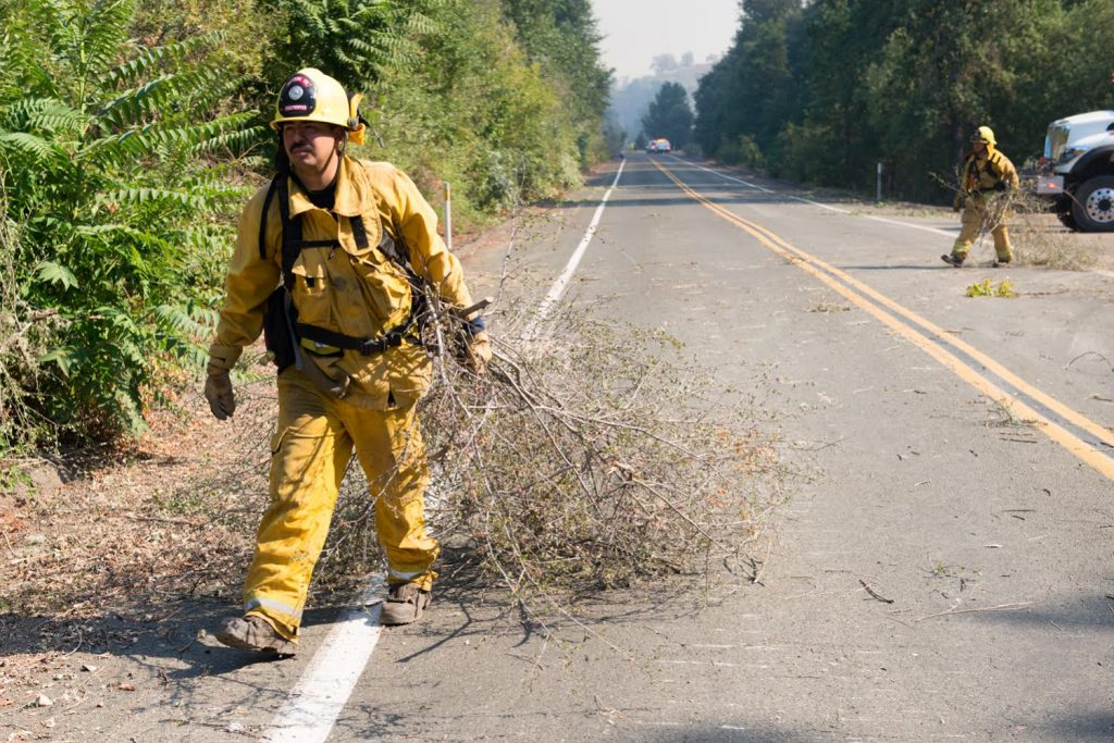 A crew from Imperial County California clears brush in preparation for a burn operation in Scott's Valley in Lake County California on Friday.