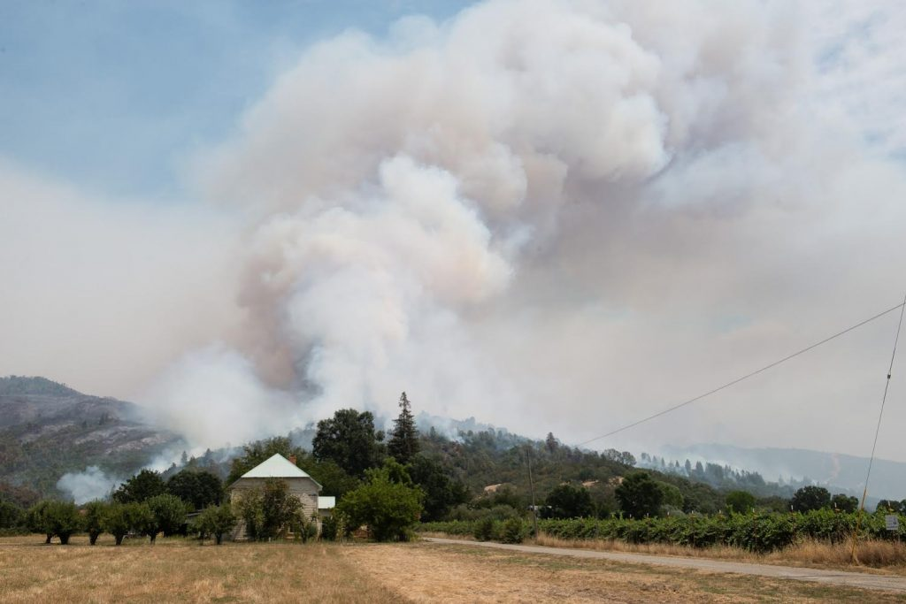 A smoke column from The Ranch Fire rises over a farmhouse in Upper Lake, California as the winds picked up.
