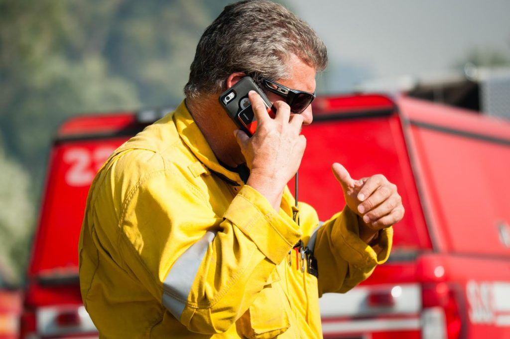 Mike Inman, Deputy of Operations for the River Fire on takes a call after strike teams stop flames from progressing in Scott's Valley in Lake County California on Friday.