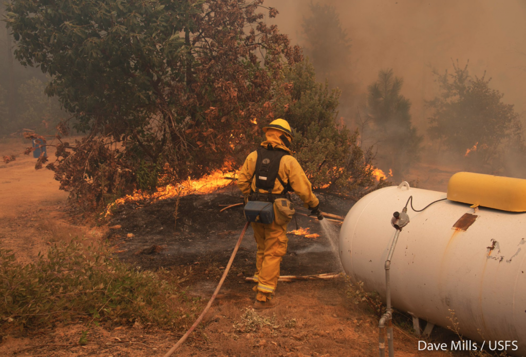 Firefighter protecting a propane tank in Division E on the Ranch Fire.