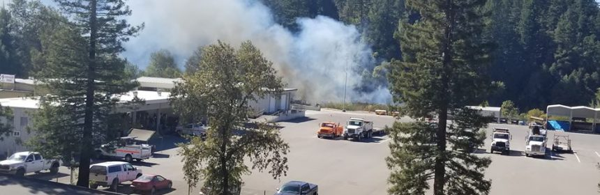 Smoke pours from a fire behind the Caltrans yard near Garberville. [