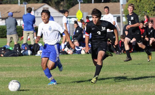 Fortuna senior captain Luis Atilano shoots toward goal.