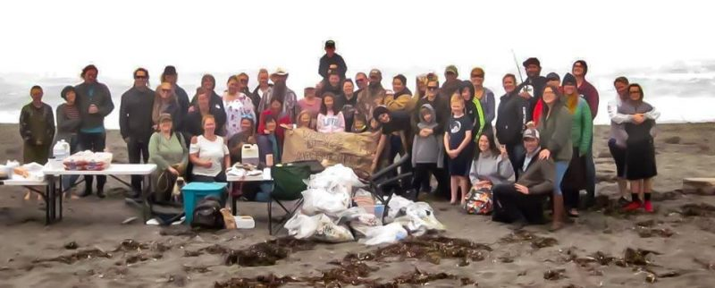 The end of the day group photo with all of the participants and trash collected. All Trash was properly disposed at the end of day. Photo Credit: Chris Damiani