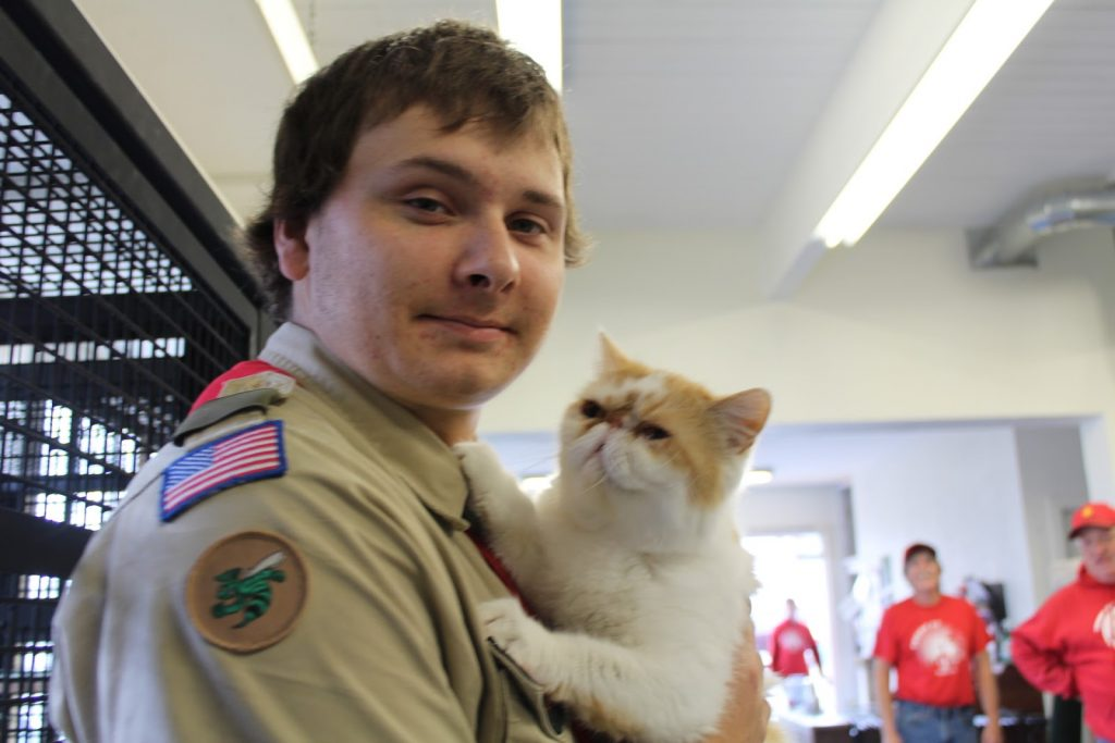 Mike Stewart being thanked by Mr. Smooshface, the HART office cat.