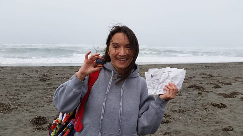 Photo of Laurie Lynch, who is the winner for the most ironic piece of trash found on the beach. Volunteer sign up forms for the Friends of the Dunes.
