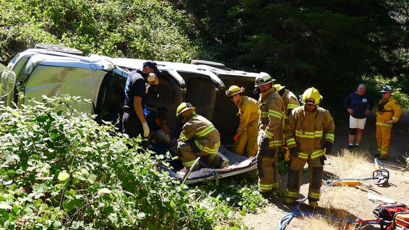 Firefighters and other emergency personnel used the Jaws of Life to open a vehicle and extract a patient.