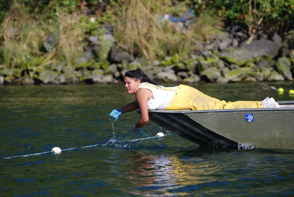 Yurok woman fishing from press release from Yurok tribe.