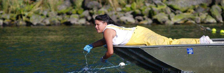 Yurok woman fishing from press release from Yurok tribe.