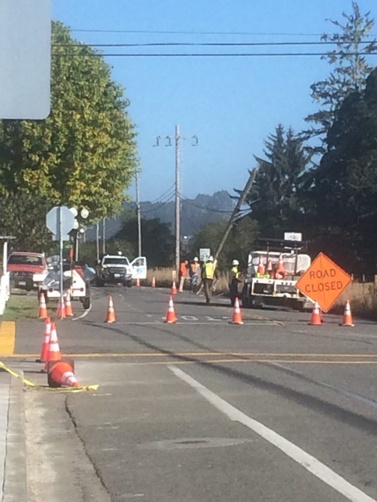 Utility crews replacing a pole on McKinleyville Avenue.