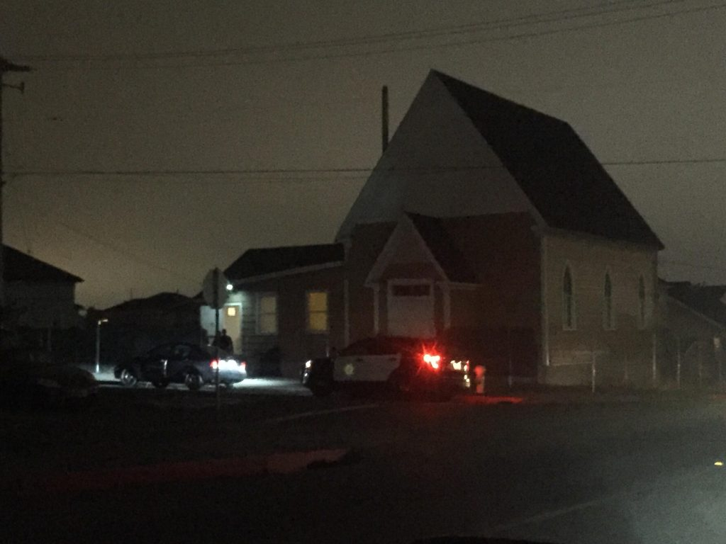 Eureka Police outside the church