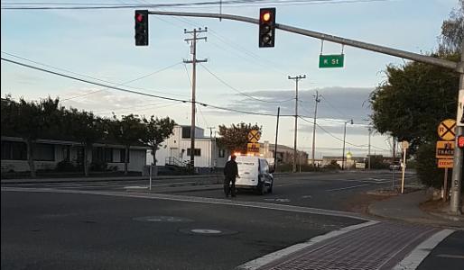 An emergency vehicle is blocking Hwy 255 near K Street in Arcata.