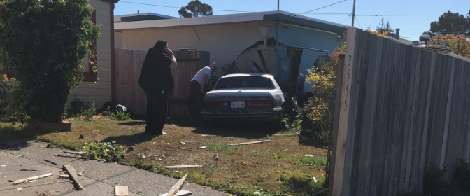 Car into fence and house