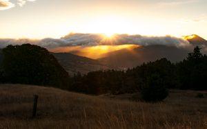 Sunrise over Bear Buttes. [Photo by Kym Kemp]