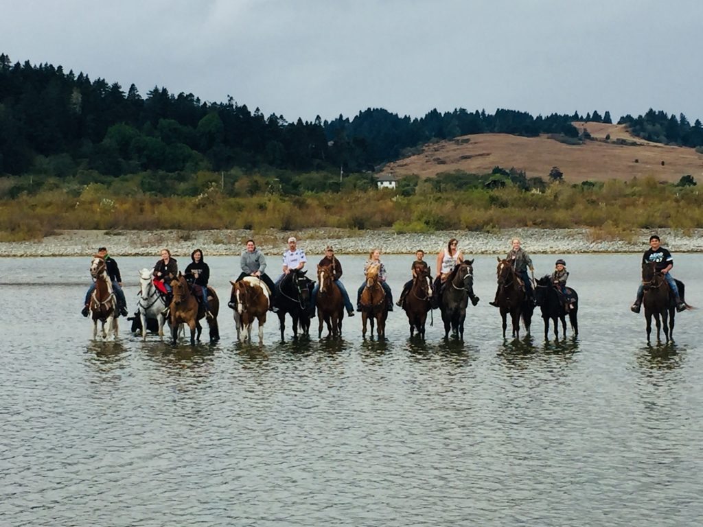 Horseback riders in river