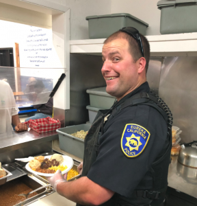 EPD officer serving a meal today.