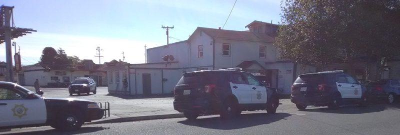 Eureka Police outside an abandoned home