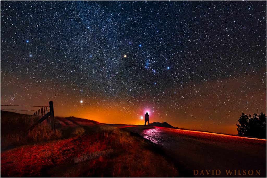 Starry sky with meteors during the Geminid meteor shower, near the Airport at Kneeland, Humboldt, California. Silhouette of David Wilson. Photo by David Wilson, December 13, 2017.Starry sky with meteors during the Geminid meteor shower, near the Airport at Kneeland, Humboldt, California. Silhouette of David Wilson. Photo by David Wilson, December 13, 2017.