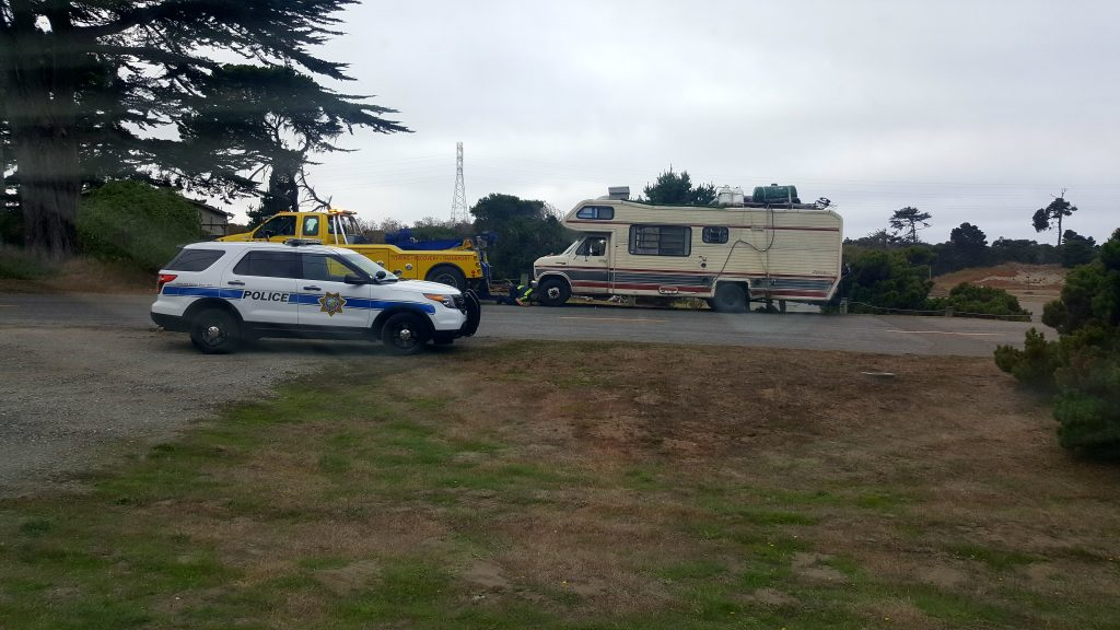 A tow truck prepared to haul away the motorhome.