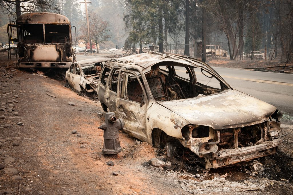 Several vehicles and a school bus were abandoned on Skyway in Paradise, Ca last Thursday as residents fled the fast moving Camp Fire